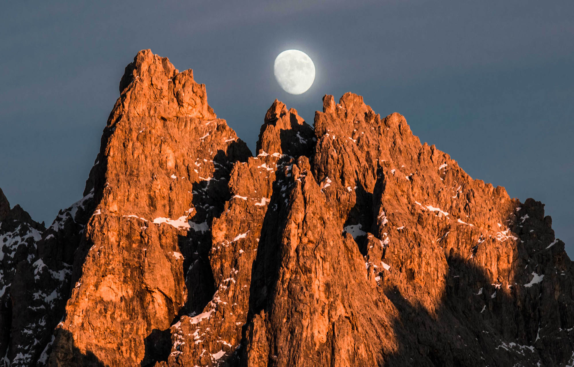 The moon raises above Pale di San Martino